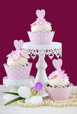 Wedding concept cupcakes on marsala background. Royalty Free Stock Image