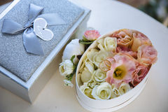 Wedding concept: Golden  Rings, Pearl necklace and Peony flowers on white table background. Stock Photos