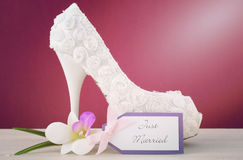 Wedding concept high heel shoe on marsala background. Royalty Free Stock Photos