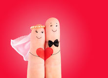 Wedding concept, newlyweds with  heart against red background Stock Photo