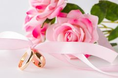 The wedding concept with rings and roses Royalty Free Stock Photo