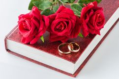 The wedding concept with rings and roses Royalty Free Stock Photos