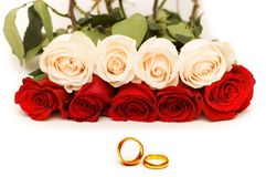 Wedding concept with roses and golden rings. Wedding concept with  roses and golden rings Royalty Free Stock Images