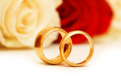 Wedding concept with roses and golden rings Royalty Free Stock Images