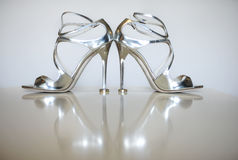 Wedding concept with silver shoes. High heels wedding shoes. Stock Image