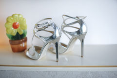Wedding concept with silver shoes. High heels wedding shoes. Royalty Free Stock Photos