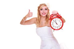 Wedding concept. Time to get married. Bride with clock. Stock Images