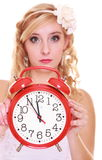 Wedding concept. Time to get married. Bride with clock. Stock Image