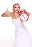 Wedding concept. Time to get married. Bride with clock. Stock Photo