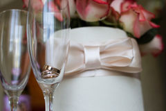 Wedding concept. Wedding rings  in a glass. Stock Images