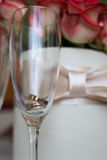 Wedding concept. Wedding rings  in a glass. Stock Image