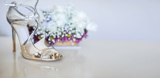 Wedding concept with white roses and silver shoes Royalty Free Stock Images