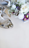 Wedding concept with white roses and silver shoes Royalty Free Stock Photo