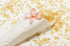 Wedding cone with rice and pink bow Stock Photo