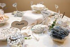 Wedding confetti buffet. Wedding table with white confetti Stock Photo