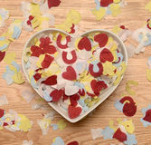 Wedding confetti in heart bowl Royalty Free Stock Photography