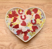 Wedding confetti in heart shaped bowl Royalty Free Stock Photography
