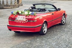 Wedding convertible car with a JUST MARRIED sign. Wedding convertible Red car with text JUST MARRIED on outdoor stock photography