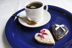 Wedding cookies with a cup of coffee on the blue plate Stock Photos