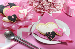 Wedding cookies on pink bridal table Stock Photos