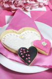 Wedding cookies on pink bridal table - vertical closeup. Stock Image
