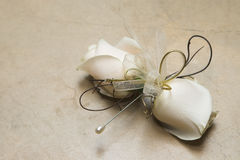 Wedding Corsage. Cream and Gold rose wedding corsage with pin stock photo