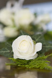 Wedding Corsage - Portrait. A groom's wedding corsage, with others in the background Stock Photo