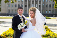 Wedding couple. Young happy wedding couple in the city square Stock Photo