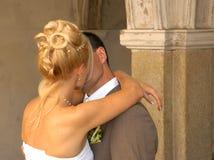 Wedding couple. Early wedding couple first kiss Stock Image