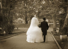 Wedding couple. Old wedding couple walking in the park in the ceremony day Stock Images