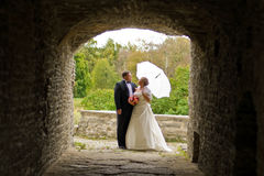 Wedding couple. In an ancient monastery alcove Stock Photo