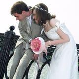 Wedding couple. Romance wedding couple looking down Royalty Free Stock Photography