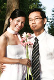 Wedding couple. With pink daisy in the park Royalty Free Stock Photo