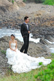 Wedding couple. At rocky cliff Stock Photography