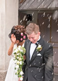 Bride and groom. Newly wed couple exits the church and get rice thrown on them Stock Photo