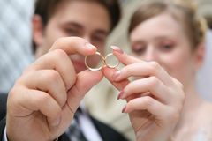 Wedding couple. With rings smiling and happy