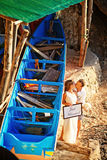Wedding couple. Near blue boat on exotic island Royalty Free Stock Photos