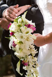 Wedding couple. The bouquet of the wedding bride stock photography