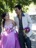 Wedding Couple-6. Wedding couple holding flower bouquet smiling in the park Stock Image