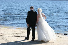 Wedding Couple. Walking by the lake stock photo