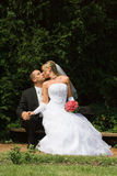 Wedding couple. Kissing outdoor in a park Stock Photos