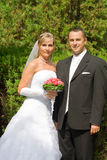 Wedding couple. Young wedding couple standing outdoor Royalty Free Stock Images
