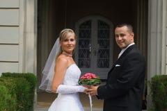 Wedding couple. Young wedding couple standing outdoor Royalty Free Stock Photos