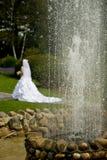 Wedding couple. Walks at a fountain Royalty Free Stock Photo