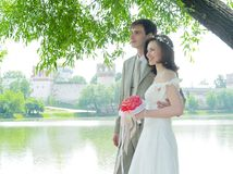 Wedding couple. Near the water and monastery Royalty Free Stock Photos