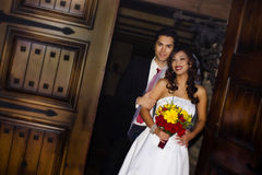 Wedding couple. Happy young wedding couple in church entrance Royalty Free Stock Photography