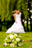 Wedding Couple. A Wedding Couple with a bouquet Stock Photo