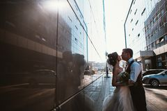 Wedding couple on backround mirror buildings.  stock images