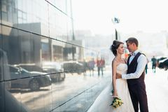 Wedding couple on backround mirror buildings.  royalty free stock photography