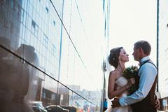 Wedding couple on backround mirror buildings.  stock photography